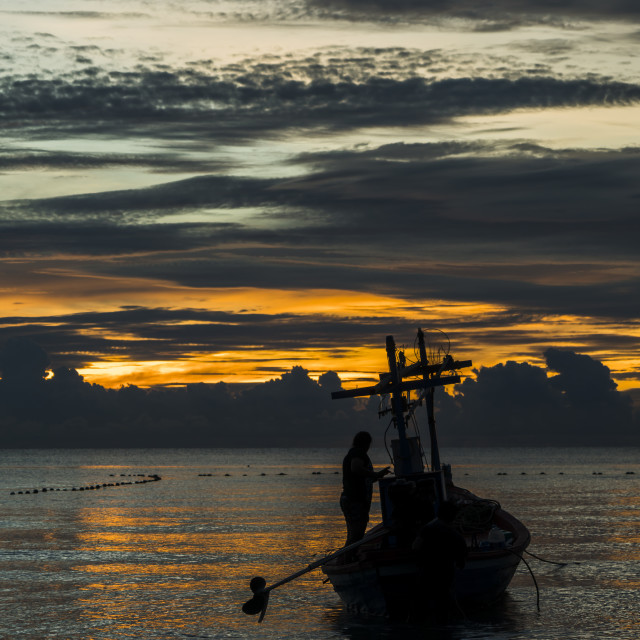 """A fishing boat is ready to work in dawn"" stock image"
