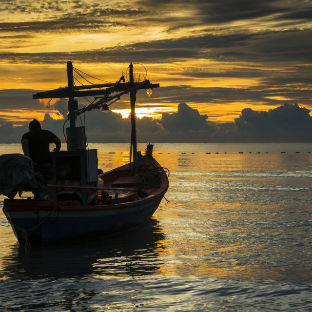 """A fisherman boat in dawn ready to work"" stock image"