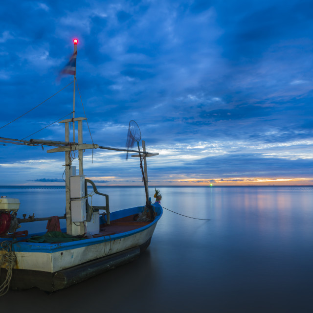 """Fish boat rest on a for work in dawn"" stock image"