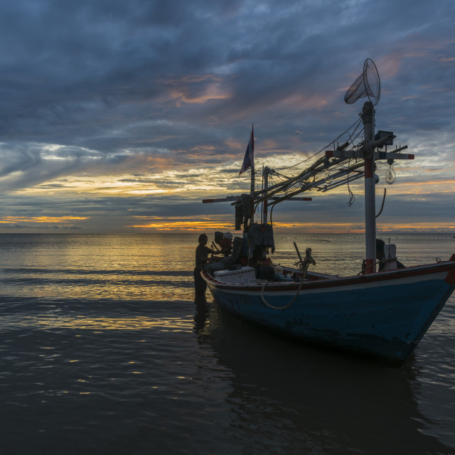 """Tropical fishing boat in dawn"" stock image"
