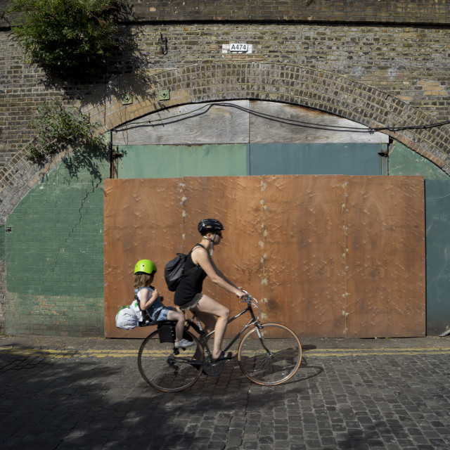 """""""Small business under railway arches by train and overground station, to be redeveloped to build luxury housing and new fashionable shops in Hackney,London,England,UK"""" stock image"""