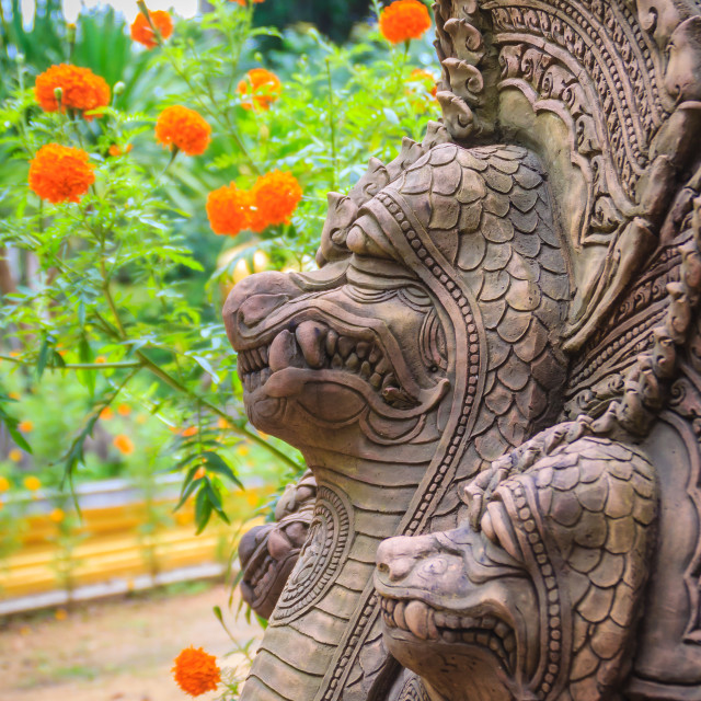"""""""Khmer' s style Naga head made from sand stone at the public temple in..."""" stock image"""