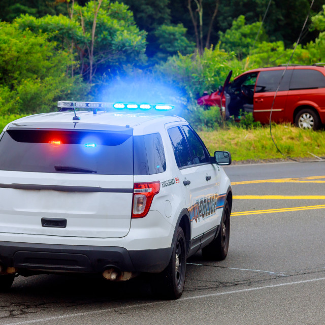 """Police flashing blue lights at accident damaged car"" stock image"