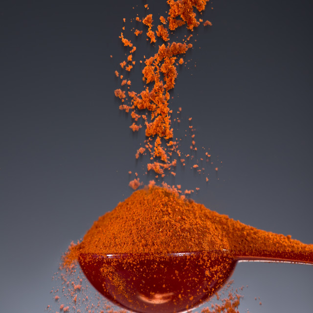 """""""1 tablespoon paprika being measured for cooking flavor."""" stock image"""