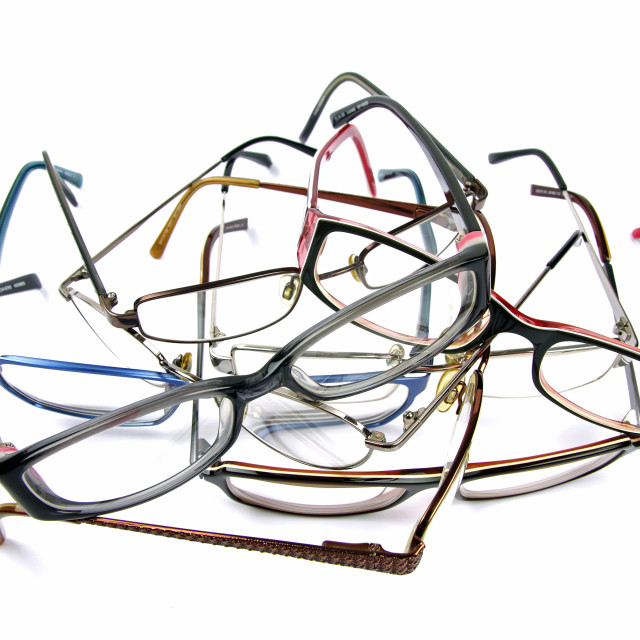 """stack of used reading glasses"" stock image"