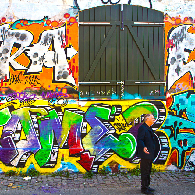 """Copenhagen, freetown Christiania - painted facade of old barrack and Alfred Hitchcock profile (just for fun)."" stock image"