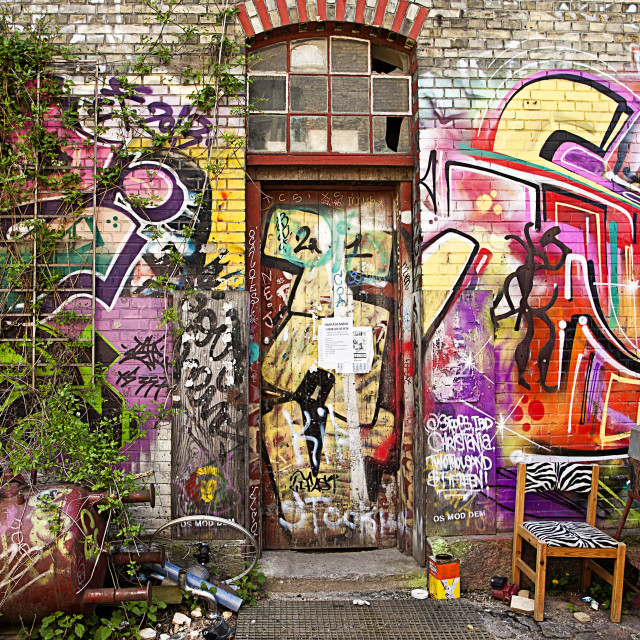 """Copenhagen, freetown Christiania - painted brick facade of industrial building"" stock image"