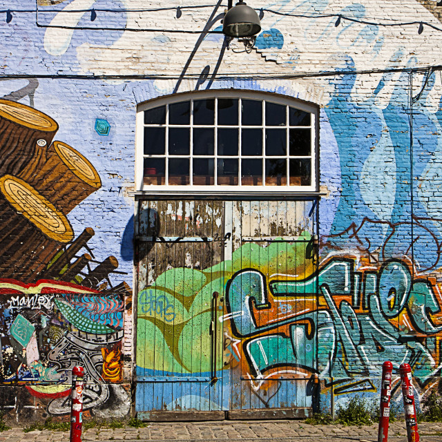 """Copenhagen, freetown Christiania - painted facade of industrial building"" stock image"