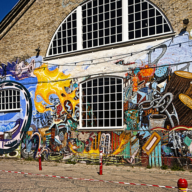 """Copenhagen, freetown Christiania - facade of industrial building with graffiti"" stock image"