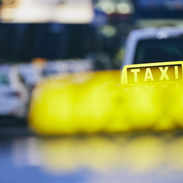 """Taxi cars at night"" stock image"