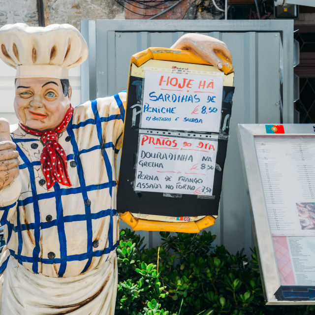 """""""Depiction of a chef giving his thumbs up promoting a menu with typical..."""" stock image"""