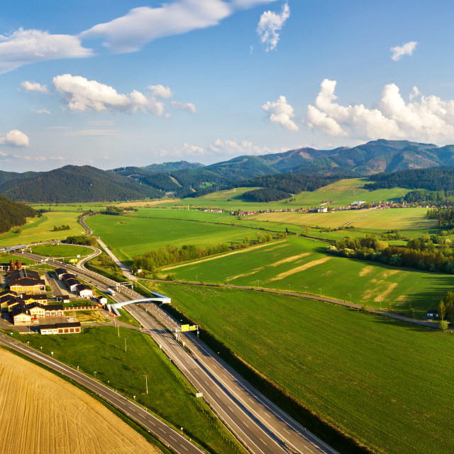 """Autobahn and road junction in mountain valley"" stock image"
