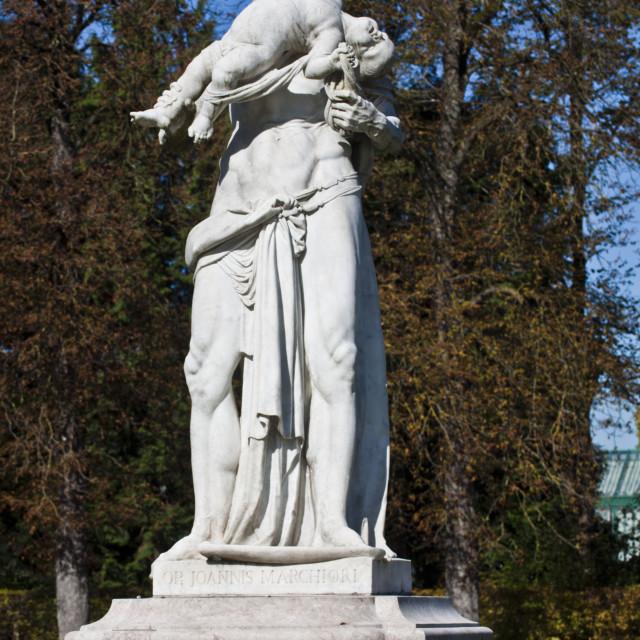 """MUNICH, GERMANY - mythological statue of Greek god Saturn eating his son"" stock image"