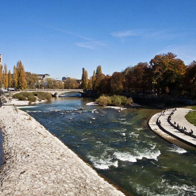 """""""Panoramic autumnal view of the blue waters of Isar river in Munich"""" stock image"""