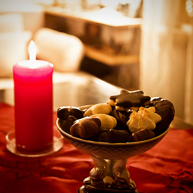 """""""Christmas eve at home, red decor and treats on the table"""" stock image"""