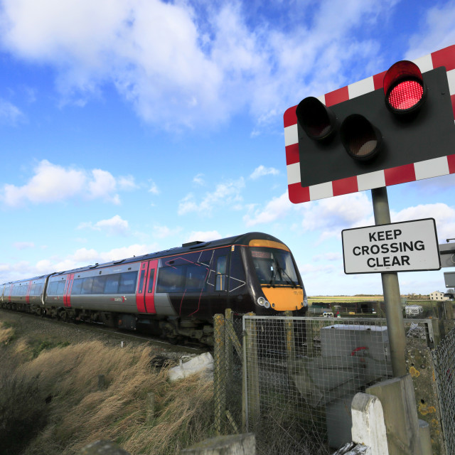 """""""Cross Country Turbostar 170110 passing an unmanned level crossing near Manea,..."""" stock image"""