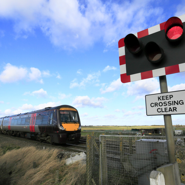"""""""Cross Country C2C Turbostar 170110 passing an unmanned level crossing near..."""" stock image"""