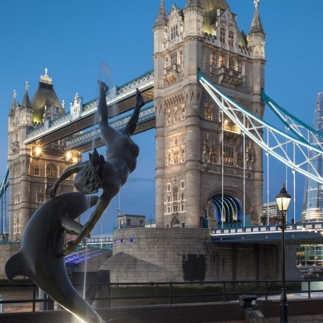 """""""David Wynne's Girl with a Dolphin statue below the Tower Bridge, London..."""" stock image"""