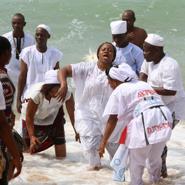 """""""Voodoo cult on a beach in Cotonou, Benin. Tranced woman."""" stock image"""