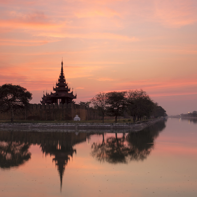 """""""Sunset view of the Royal Palace, City Moat and City Wall in Mandalay, Myanmar..."""" stock image"""