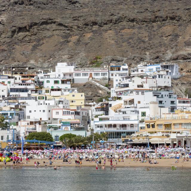 """People enjoying the beach at Puerto de Mogan"" stock image"
