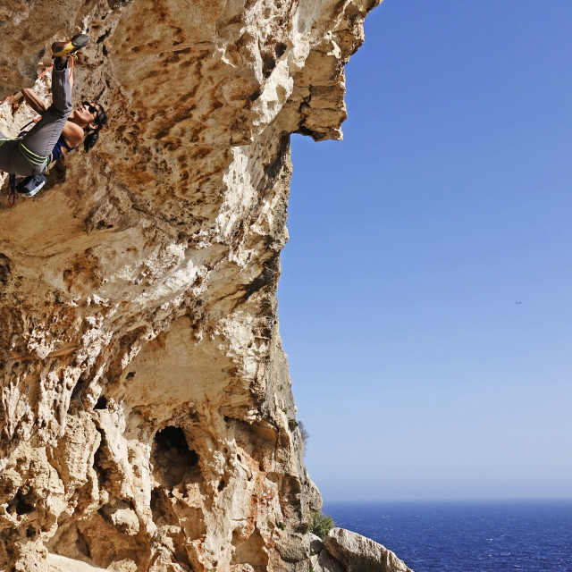 """""""Rock climber in action on the cliffs of Malta"""" stock image"""