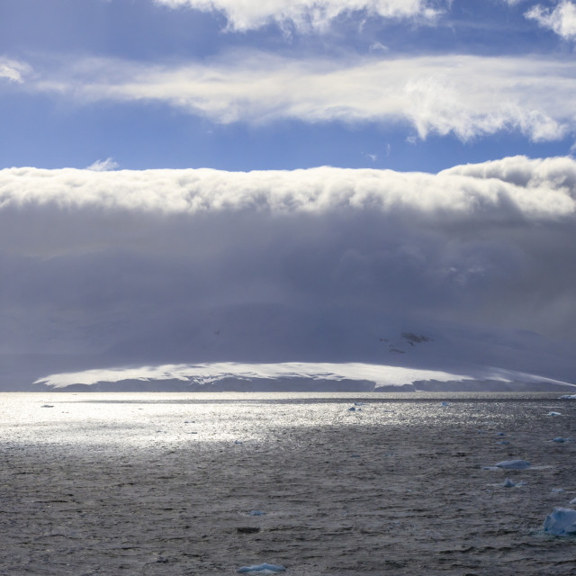 """Arcus cloud over the mountains of the Gerlache Strait, blue sky, Antarctic..."" stock image"