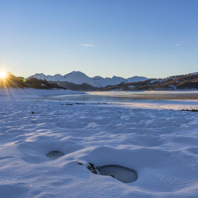 """Italy, Abruzzo, Gran Sasso National Park, Campotosto lake in Winter at sunrise"" stock image"