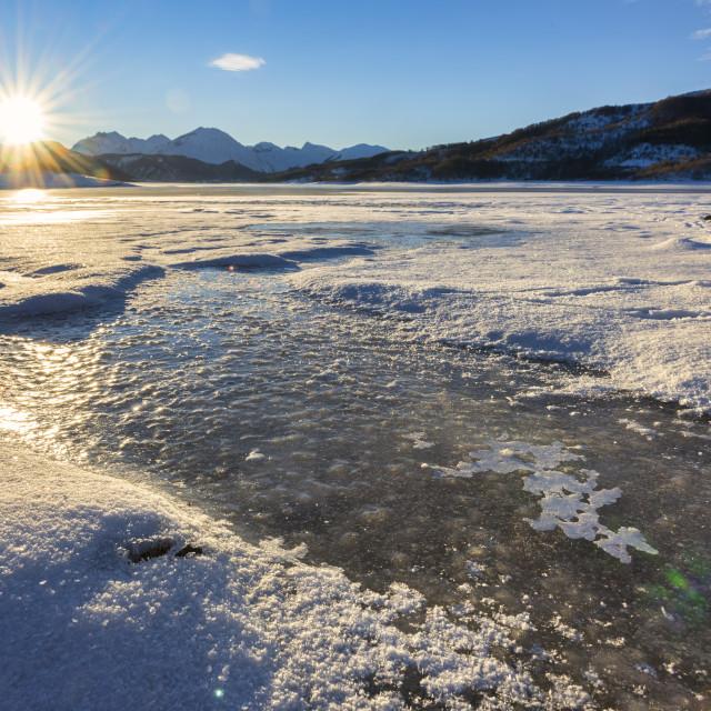 """Italy, Abruzzo, Gran Sasso National Park, Lake Campotosto at sunrise in Winter"" stock image"
