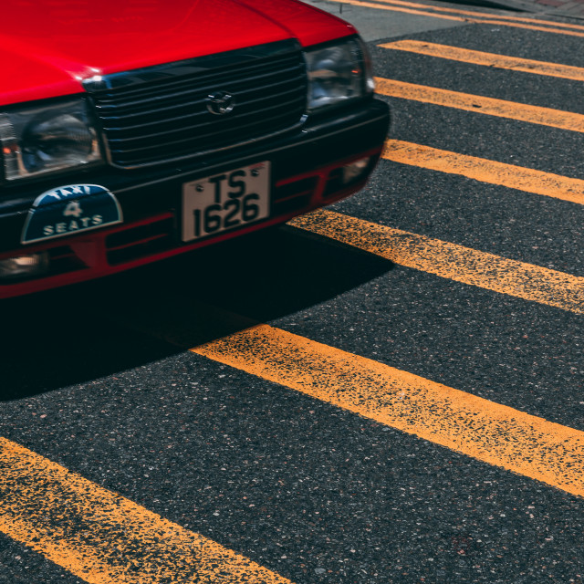 """Red taxi car on road crossing in Hong"" stock image"
