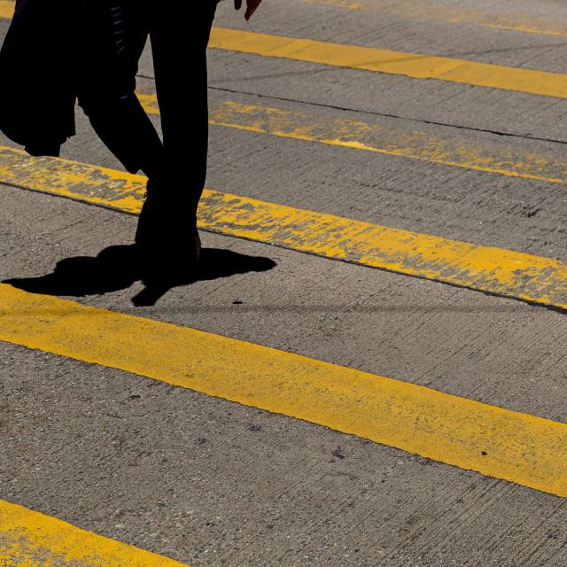 """Businessman wearing suit crossing road in Hong Kong"" stock image"