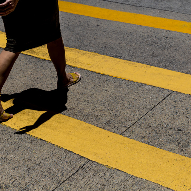 """Woman crossing the road in Hong Kong"" stock image"