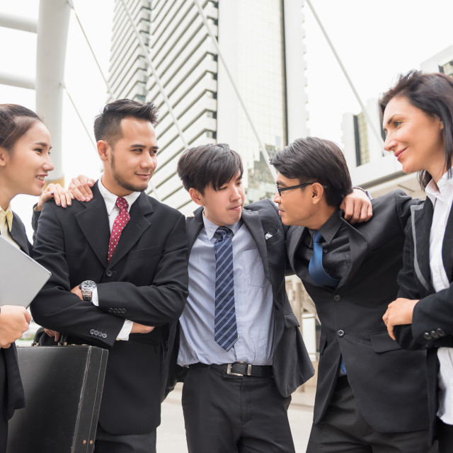 """Happy Business team cheer up in town"" stock image"