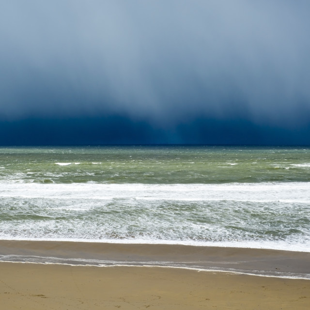 """winter rain storm approaching beach"" stock image"