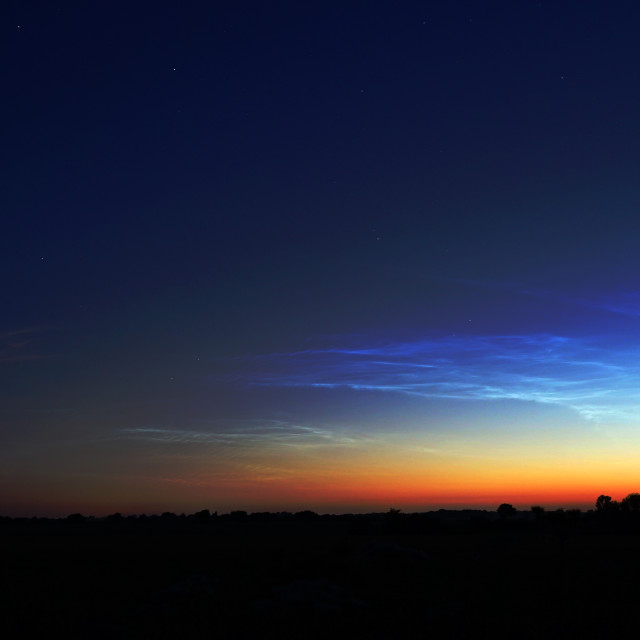 """Glowing Noctilucent Clouds A Rare Phenomenon"" stock image"