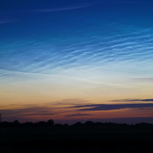 """A Sea of Noctilucent Clouds A Rare Phenomenon"" stock image"
