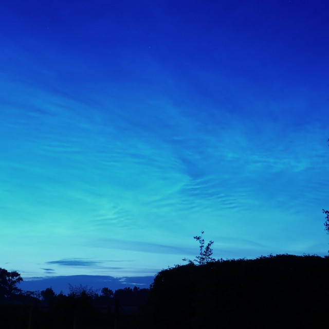 """Blue sea of Noctilucent Clouds A Rare Phenomenon"" stock image"