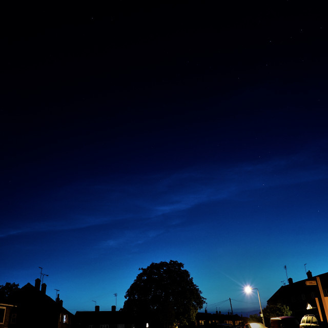 """Noctilucent Clouds from a Rural Street iin Essex"" stock image"