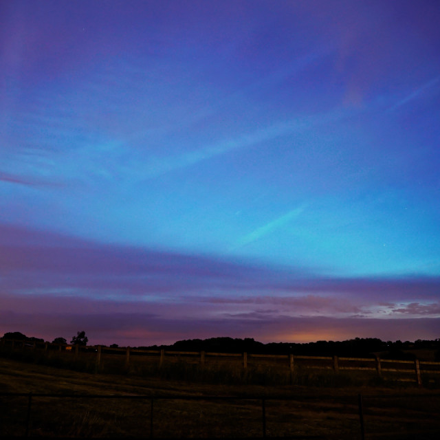 """Glowing Blue Noctilucent Clouds Phenomenon"" stock image"