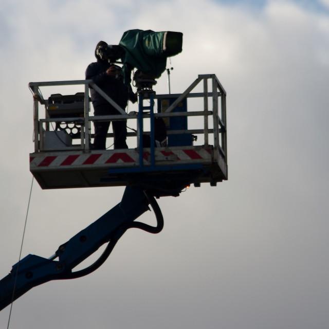 """TV cameraman on high platform"" stock image"