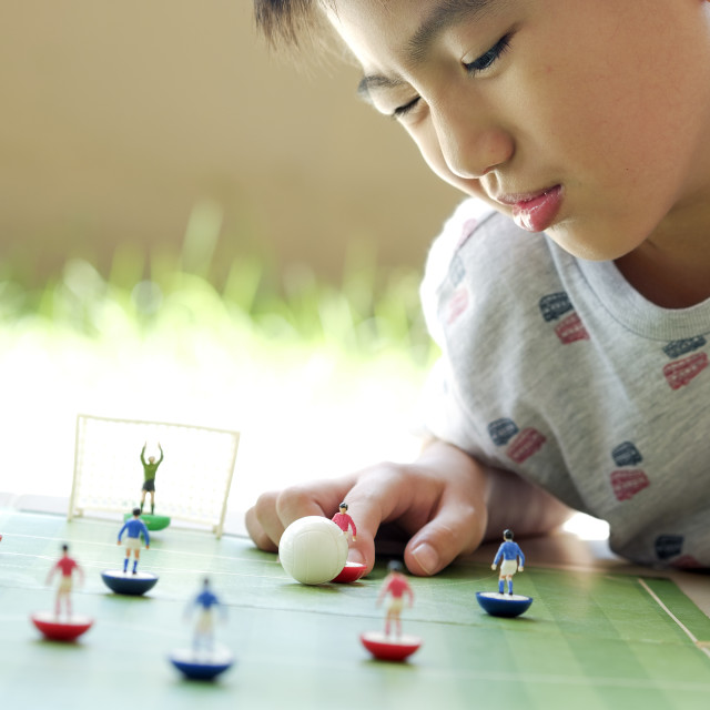 """Young Boy Playing Table Soccer"" stock image"