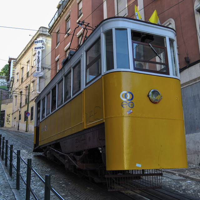 """Lisbon, Portugal - May 11, 2010: The Gloria Funicular (Elevador da Gloria) in the city of Lisbon, Portugal. Gloria Funicular connects the Pombaline downtown with Bairro Alto"" stock image"