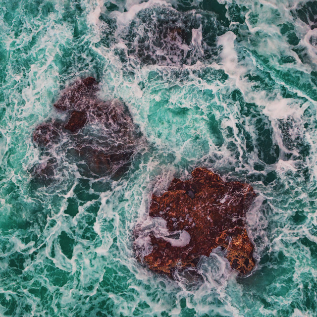 """""""Aerial view of rocky coastline with crashing waves"""" stock image"""