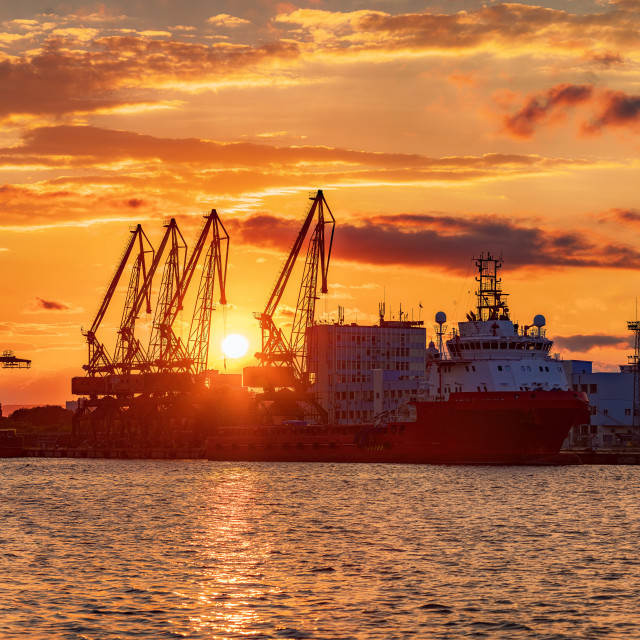 """""""Sunset over sea port and industrial cranes, Varna"""" stock image"""