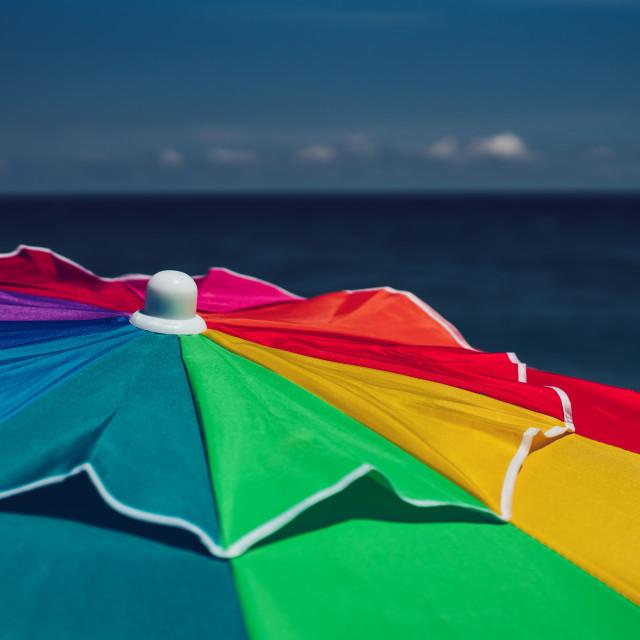 """Colourful umbrella on the beach"" stock image"