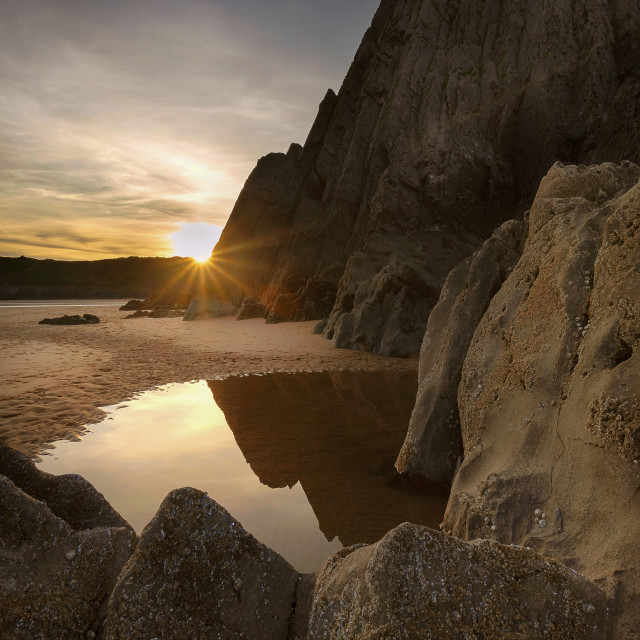 """Sunset at Three Cliffs Bay Gower"" stock image"