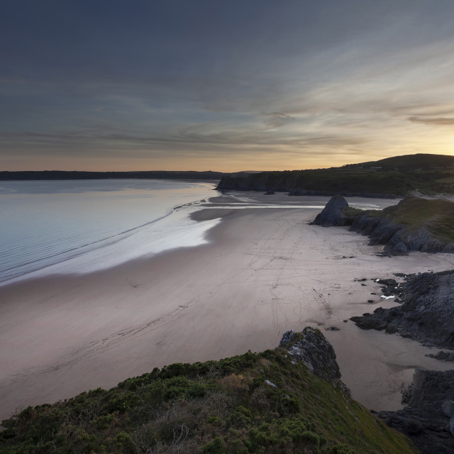 """Three Cliffs Bay and The Great Tor"" stock image"