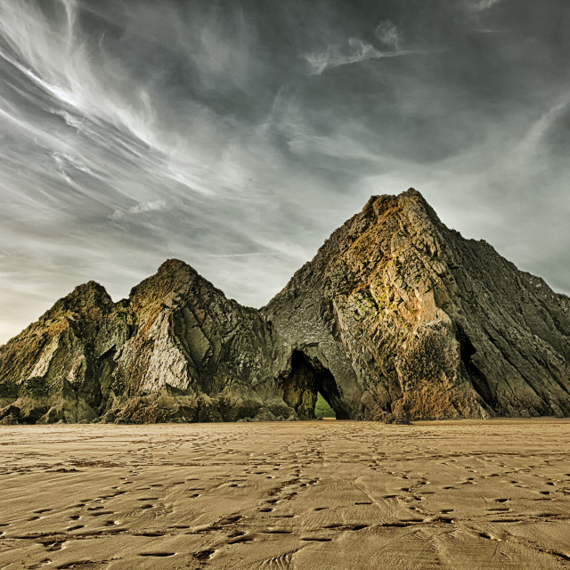 """Jagged and dramatic Three Cliffs Bay"" stock image"