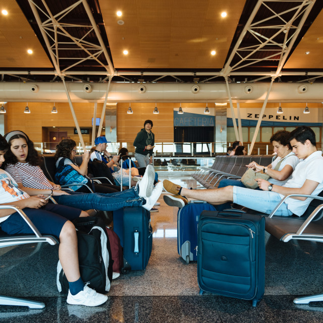 """Unidentified people waiting in boarding gate lounge in airport"" stock image"