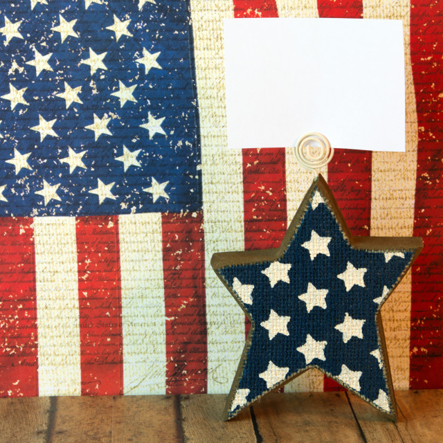 """Fourth of July star with copy space with an American Flag backgr"" stock image"
